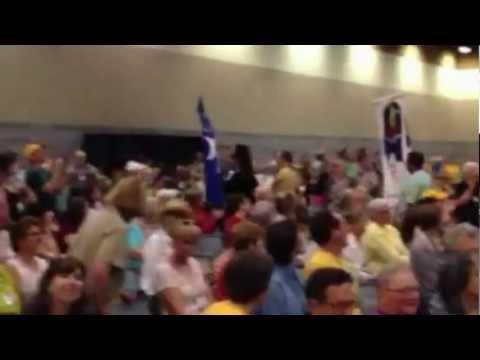 Ali carries Pacific Unitarian Church banner