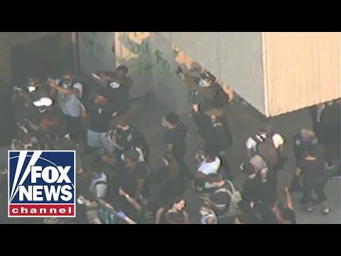 Protests erupt outside
