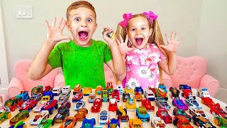 Roma and Diana play with toy cars
