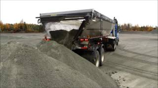 Live Bottom Trailer Dumping Sand
