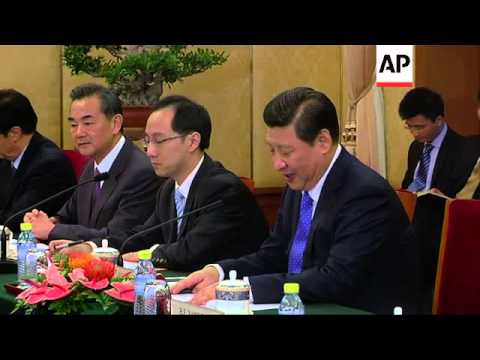 Indian Prime Minister Singh meets Chinese President Xi Jinping