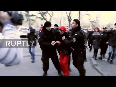Download Ukraine: Woman detained while honouring Defender of Fatherland Day in Odessa