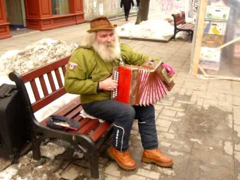 Lithuanian folk romance. Russian garmoshka. Street musician in Kaunas.
