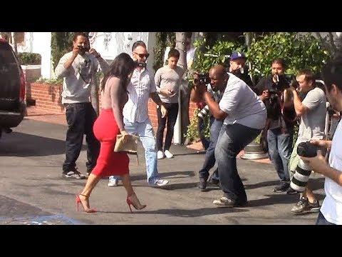 Kim Kardashian Causes Chaos In Hip-Hugging Red Skirt  [2014] thumbnail