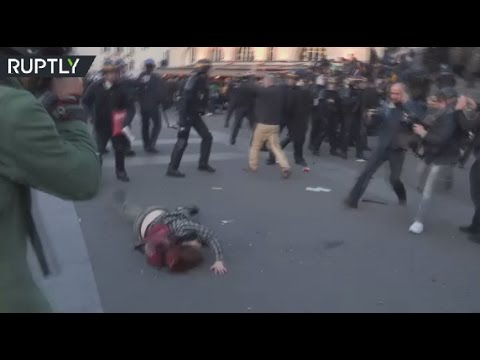 Paris post-vote demo: Police throw woman to ground, spurn and spray protesters in face