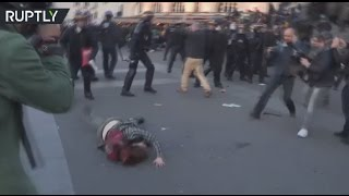 Paris post vote demo  Police throw woman to ground, spurn and spray protesters in face