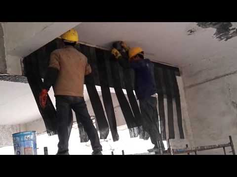 strengthen concrete beam with two layers of carbon fiber reinforced fabric