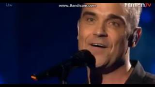 "Take That with Robbie singing ""The Flood"". Brits Icon Award"