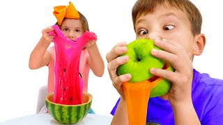 Max and Katy play with fruits slime