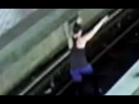 Woman practises yoga on Metro tracks
