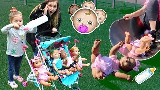 Kids Pretend Play with Baby Dolls feeding and Playtime at the Playground video
