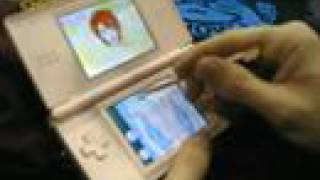 "Karian teaches Dave (Snafu Comics) to play ""Duel Love"" on her DS at..."
