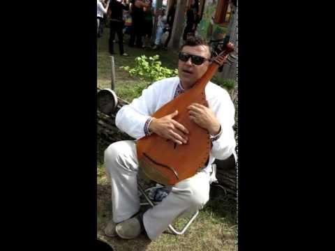 playing a bandura, I think, at the Sorochyntsi Fair, Myrhorod, Poltavs'ka, Ukraine