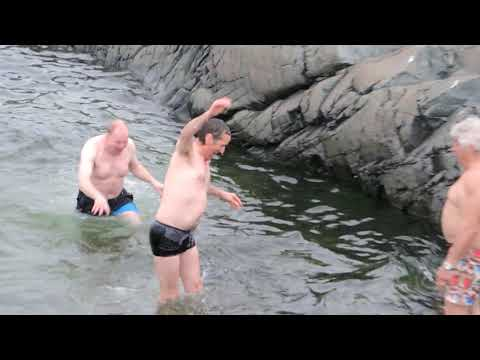 Polar plunge at brown station, antarctica.  Water temperature 2 degrees celsius