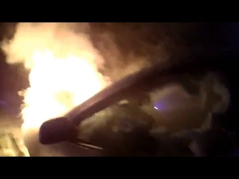Watch Dramatic Rescue Of Officer Saving Woman From Burning Car