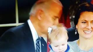 WHAT IS BIDEN DOING TO THIS BABY?