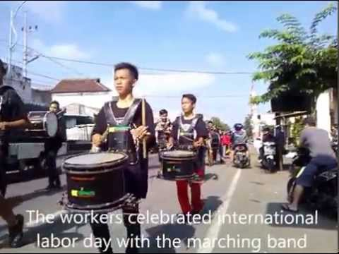 The workers celebrated international labor day with the marching band