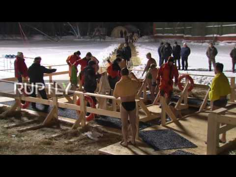 Russia: Orthodox believers plunge into Moscow's freezing waters for Epiphany