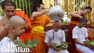 Rescued Thai boys have heads shaved before Buddhist ceremony