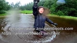 WetLook 199 Girl in Shorts and Rubber Boots in Deep Water