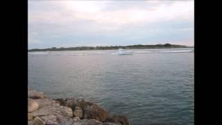 Jetty Boardwalk Boats Leaving Inlet