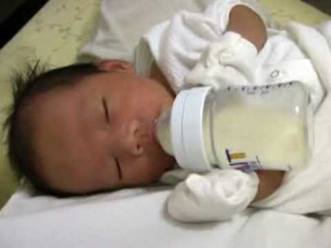 Baby holding milk bottle - YouTube