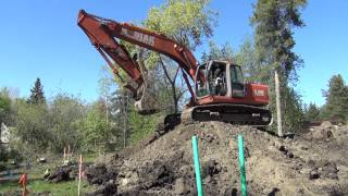 Excavator Climbs over Big Dirt Pile - Pearce-Bonville Homestead