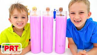 Vlad e Nikita brincam com bonecas da Barbie