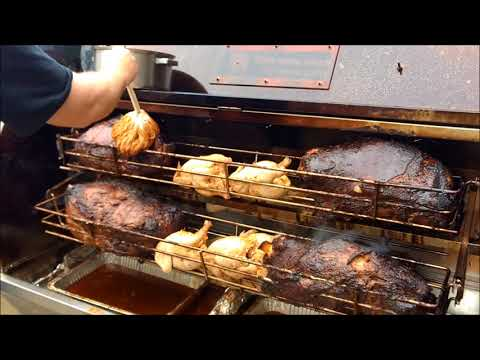 Cooking Pork Shoulders And Chickens On The Rotisserie Style Baskets On Our 59