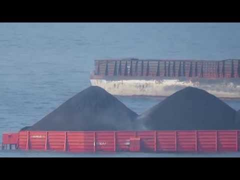 Tugboat Pulling Barge On The Ocean