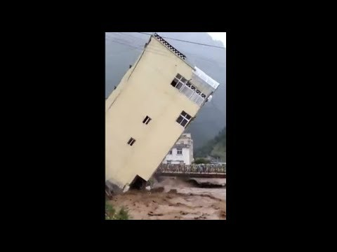 Omg! Buildings crumbles like pack of cards in flood-hit Sierra Leone