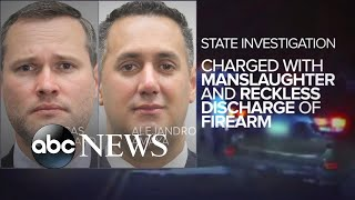 2 police officers turn themselves in, nearly 3 years after fatal shooting