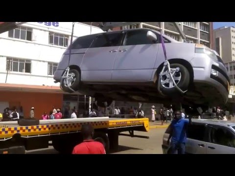 Harare City Council lifting a car parked on no parking area
