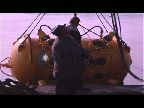 Underwater Research Bell lowered into water by crane and divers dive into water. HD Stock Footage