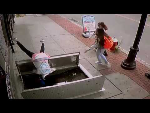 Texting lady tumbles through open sidewalk doors New York Po & Texting lady tumbles through open sidewalk doors New York Po - YouTube