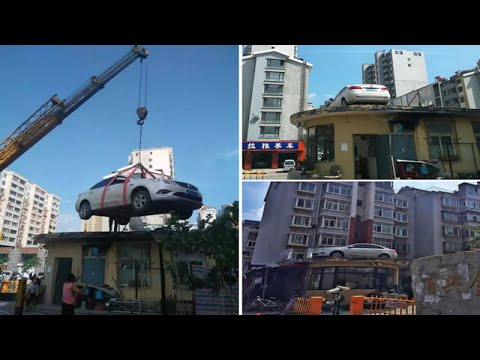 Man uses a Crane to move woman's car to ROOF after she blocked the entrance for 38 hours