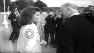 Jacqueline Kennedy talks with Irish President Eamon De Valera during her vacation...HD Stock Footage