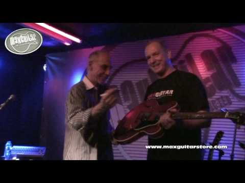 Larry Carlton Signs a guitar for Max Guitar