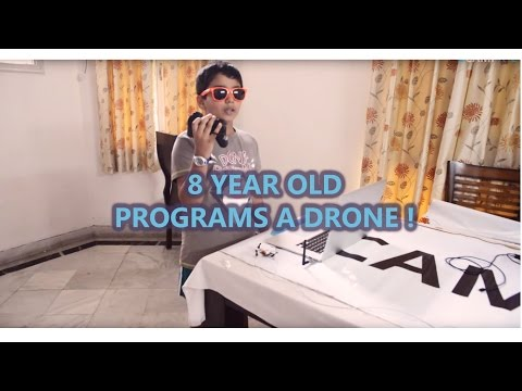 8-year old programs a drone!