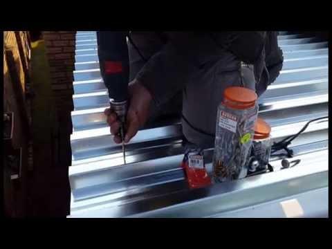 Contractor installing Eureka Tek Screws