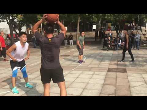 young Chinese police playing B ball and the police station