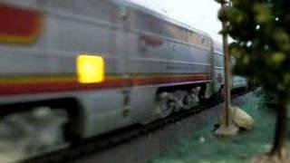 Santa Fe passenger train passes a waiting freight train
