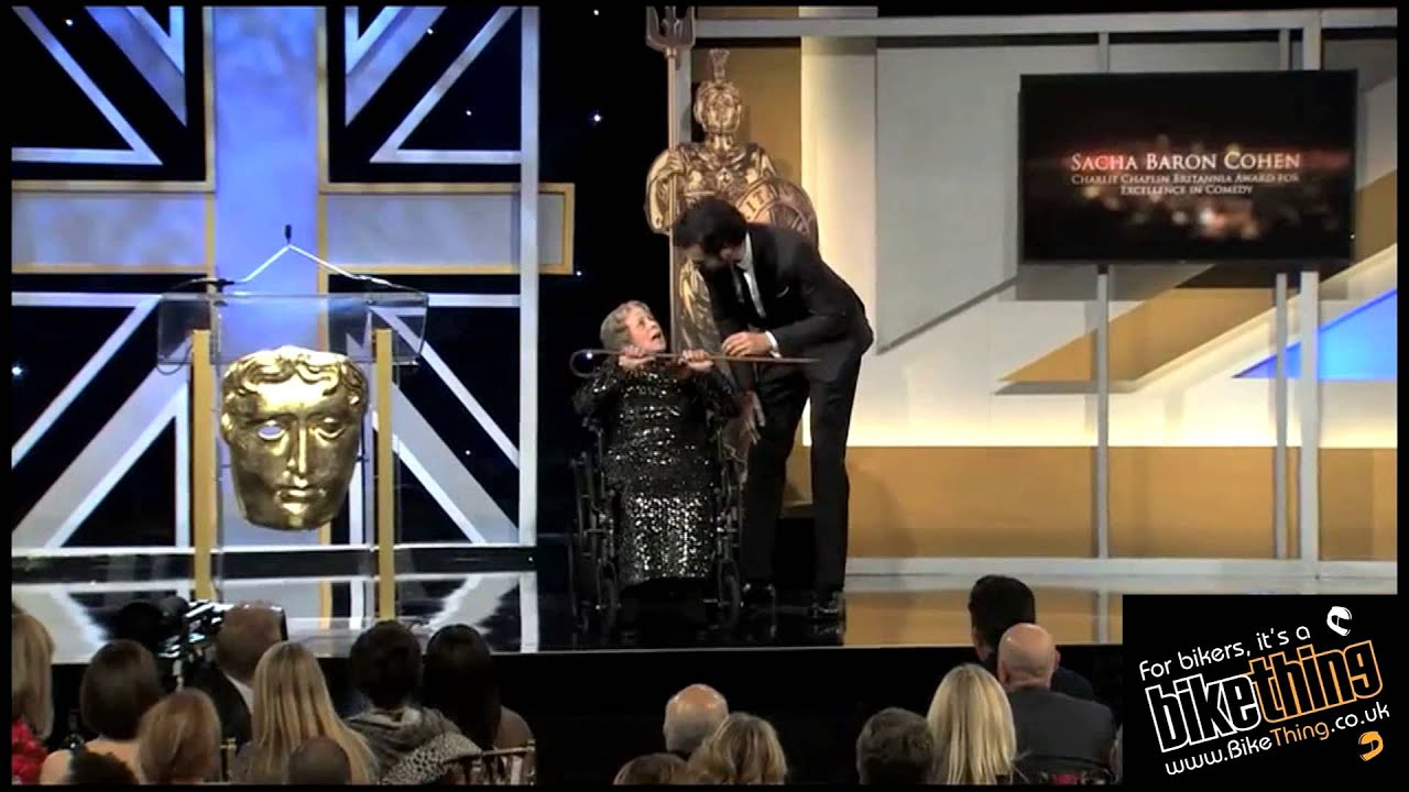 Sacha Baron Cohen - Charlie Chaplin Britannia Award - pushes woman in  wheelchair off stage at awards