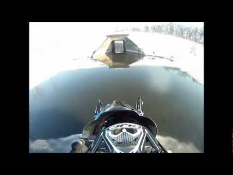 Snowmobile water skipping through narrow tunnel on an Arctic Cat Crossfire 700 with a GoPro