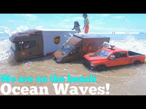 The Ocean Waves are Hitting the TOY TRUCKS! UPS Delivery Toy Trucks on the BEACH. Kids' Toys