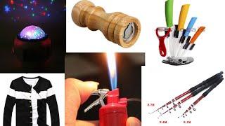 Посилки з Китаю від 7.12.14. Керамічні ножі, проектор неба, кофта, спінінг, млин.