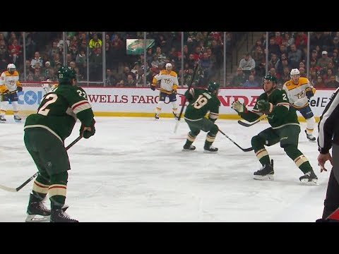Hockey Player Flips Stick Back to Teammate with Ease