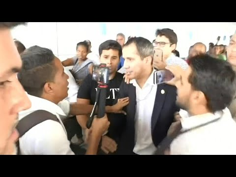 Opposition leader Guaido arrives in Venezuela after international tour | AFP