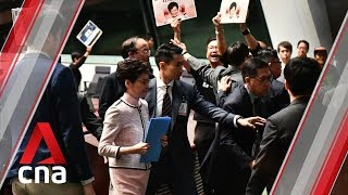 Carrie Lam aborts policy speech due to heckling from lawmakers