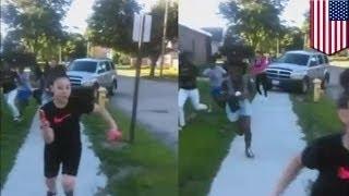 Папаша въехал в группу подростков, чтобы защитить дочь в кулачном бою